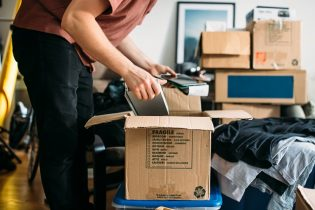 man packing boxes making a career change
