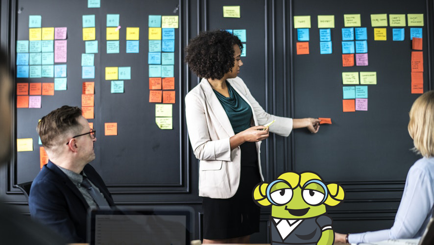 meeting with sticky notes on the wall